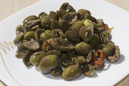 pitted: traditinal  mediterranean recipes: flattened olives