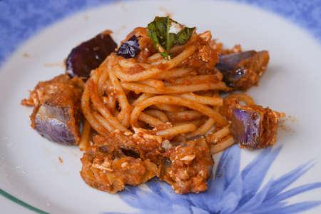 traditinal: traditinal Sicilian dish: pasta with tomato sauce, cheese and eggplants.