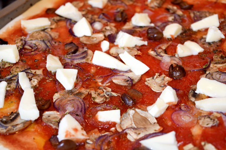 woodfired: traditional Italian pizza: pizza capricciosa with tasty ingredients