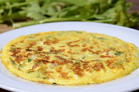 panino: vegetarian dish: omelette with zucchini and aromatic herbs Stock Photo