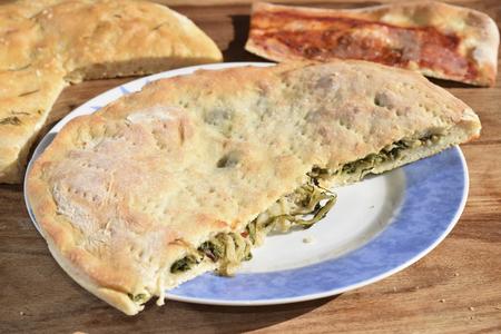 escarole: stuffed pizza with escarole and pine nut