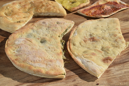 leavening: variety of stuffed pizzas with vegetable and ham
