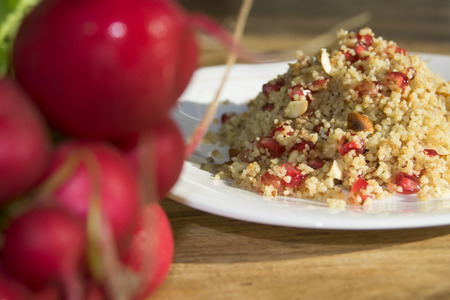 couscous: fresh and healthy food: couscous with pomegranate and walnuts