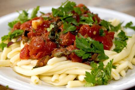puttanesca: traditional and typical roman dish: pasta alla puttanesca Stock Photo