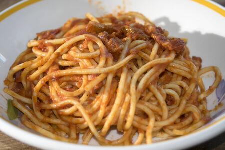underbelly: tasty Italian speciality: spaghetti allamatriciana or spaghetti with a tomato sauce with pancetta