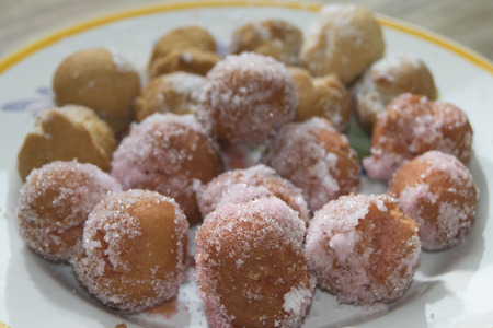 chiacchiere: a traditional dessert of carnival with sugar and liqueur
