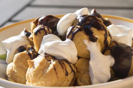 profiterole: homemade profiterole with chocolate cream and cream puff