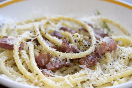 pepe: Italian speciality: the gricia, a type of amatriciana with fried oil bacon and pecorino Stock Photo