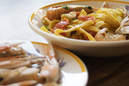 scampi: traditional Italian seafood: fettuccine with scampi