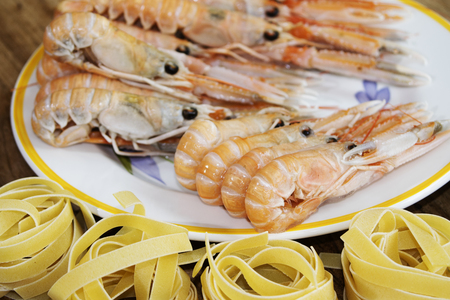 fished: Scampi of the mediterranean sea just fished with raw fettuccine