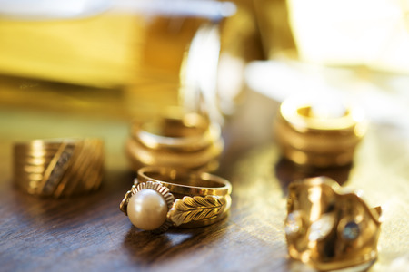 rings with precious stones in acollection of family jewels photo