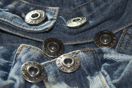metallic button: Metallic button in sequence  of a jacket jeans Stock Photo