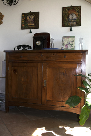 ancient buffet  of fine wood in a domestic home photo