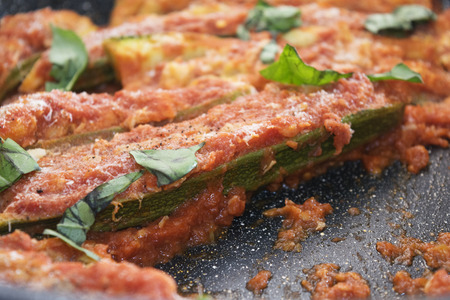 stuffed zucchini with filling of tuna and stir-fried in oven