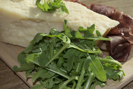 appetiser: italian appetiser and second course: bresaola arugula and parmesan Stock Photo