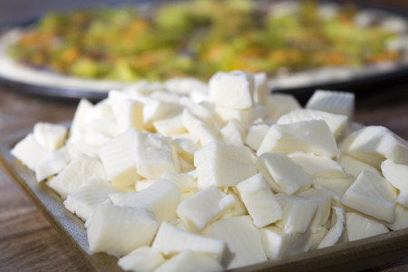 ingredients for pizza: cube of Italian mozzarella Stockfoto