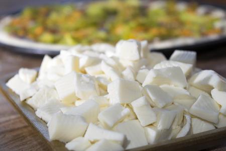 pizza maker: ingredients for pizza: cube of Italian mozzarella Stock Photo