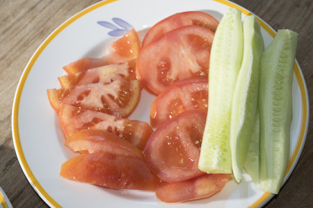 crudite: crudites of vegetables with slices of tomatoes and cucumbers