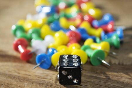 tool and die: objects : die and colored pushpins on a table