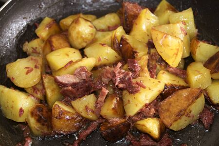 canned meat: canned beef meat and potatoes stir-fried and served as starter Stock Photo