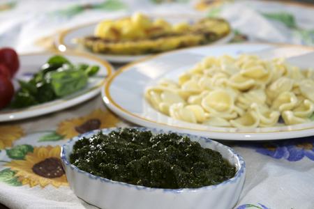 genoese: handmade egg orecchiette and fresh genoese pesto Stock Photo