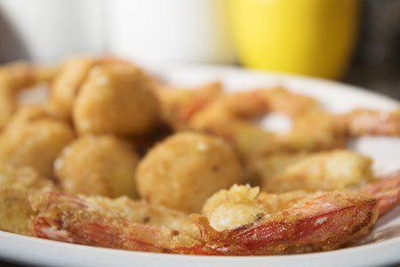 bluefish: battered shrimps and balls of salmon for a crisp fry of fish