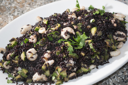 Venus black rice with prawns and courgettes and aromatic herbs
