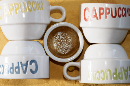 long shots: ristrected espresso coffee near some colored cup