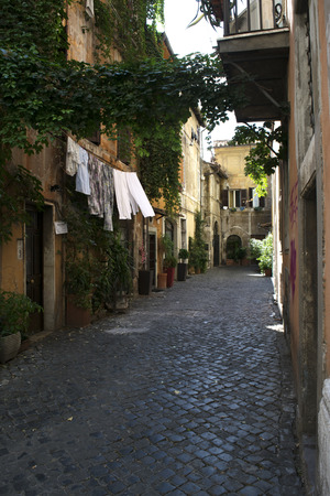 cobbled: the rione of trastevere in Rome with Its  narrow cobbled streets lined by ancient houses Stock Photo