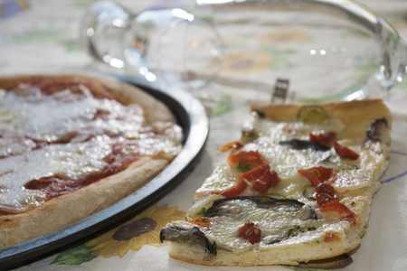 leavening: homemade pizza:  parmigiana by the slice and margherita round pizza