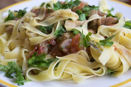 porcini: porcini mushrooms tagliatelle with pachino tomatoes and parsley