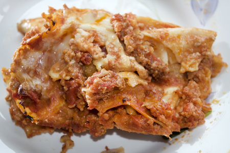 fillo: lasagna portion at the bolognese sauce on a dish white