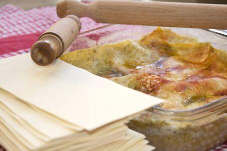 white lasagne with genoese pesto and tomato sauce