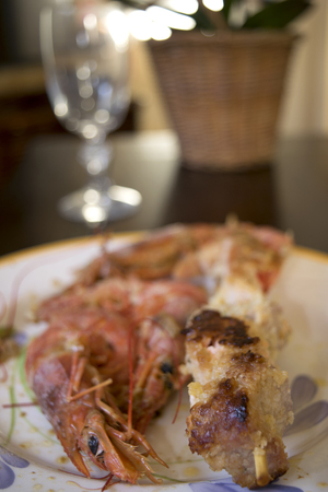 jumbo: breaded and fried skewers of fish with near some jumbo prawns