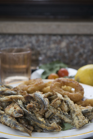 mixed fish fry with anchovied and battered calamari