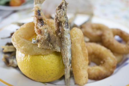 battered: fish fry with floured anchovies and battered calamari rings