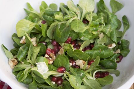 valerian: healthy salad of grapes of pomegranate valerian and kernel walnuts