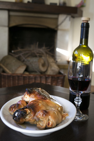 porker: eating around the fireplace with red wine and roast piglet