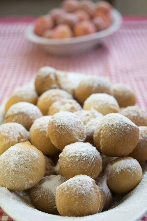 traditon: Carnivale Italian castagnole or favette or strufoli a dessert of the traditon of the northern and central Italy