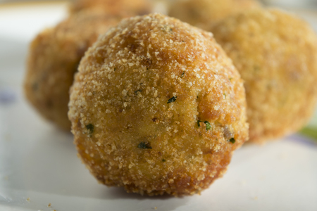 fried sicilian arancina a traditional recipe of sicily made with rice with filling of mozzarella and ragout