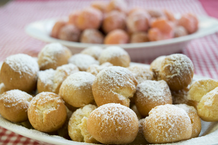 zeppole: castagnole are fried  sweet dough balls with icing sugar famaus In Italy as Carnival dessert