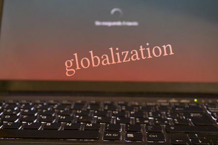 imperialism: concept of globalizatione and modern technologies with a writen on the desktop of the a computer