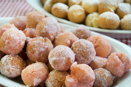 chiacchiere: castagnole are fried  sweet dough balls with icing sugar famaus In Italy as the dessert of Carnival.