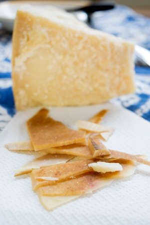 chunks: chunks and rind of parmigiano cheese with near a big piece of heart
