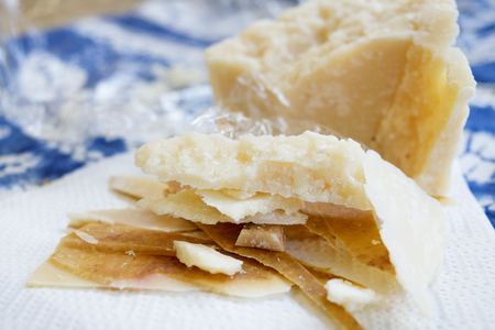 rind: chunks and rind of parmigiano cheese with near a big piece of heart
