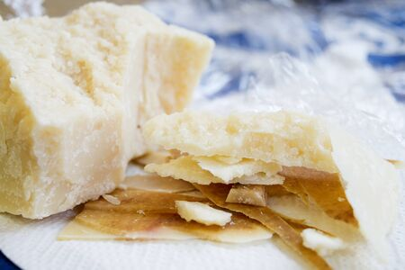 morsel: chunks and rind of parmigiano cheese with near a big piece of heart
