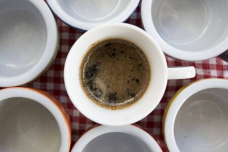 coffeecup: flat lay of rows of small coffee-cup with creamy espresso coffee
