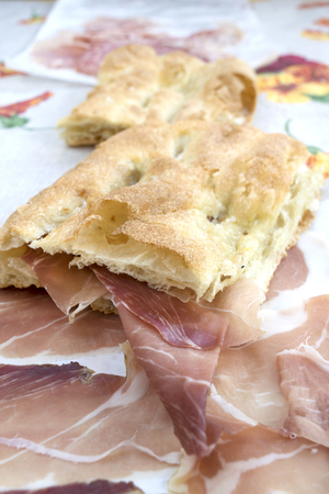 serrano: focaccia filled with serrano jamoncured ham as break lunch Stock Photo
