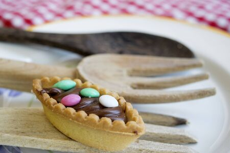 sugared: pastry with chocolate cream and colored sugared almonds Stock Photo