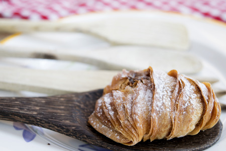 choux bun: neapolitan sfogliatella a  puff filled with ricotta and candied fruit Stock Photo